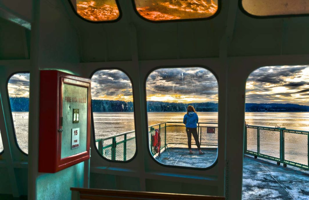 Passenger looks out at Whidbey Island approaching.