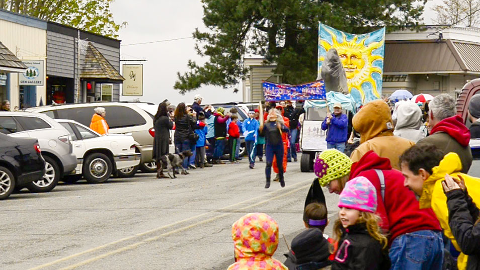Crowd watches the start of the Welcome the Whales Parade in Langley Washington