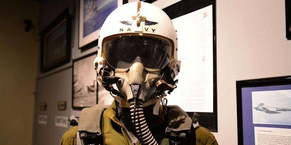 A World War Two era pilot's helmet and uniform with oxygen mask.