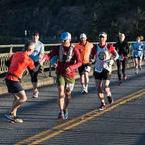 Runners cross Deception Pass bridge.