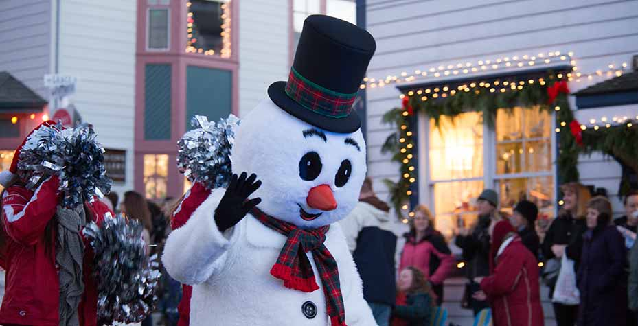 Frosty the Snowman greets people at the Greening of Coupeville parade.