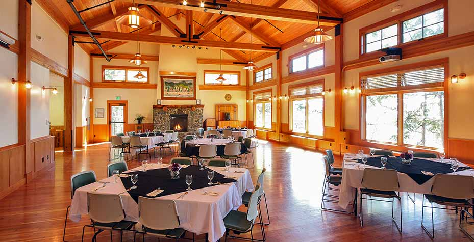 A large hall with many windows and wooden beams make for a warm and clean atmosphere.