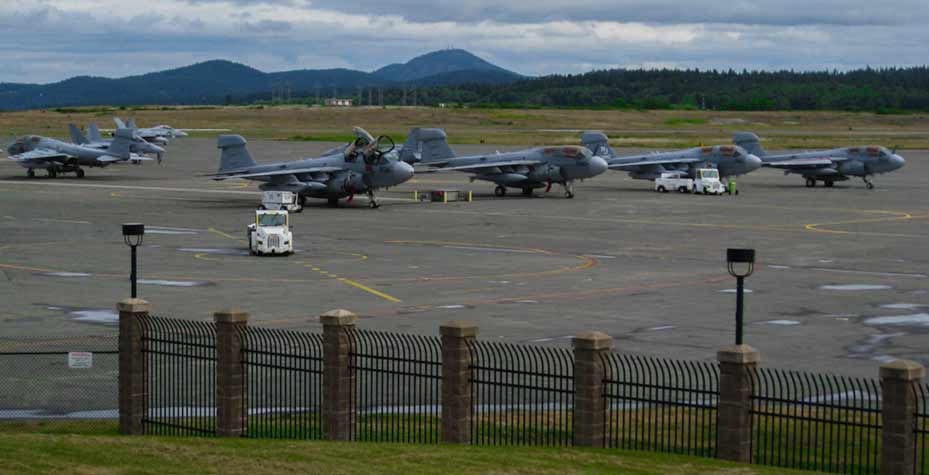 Several jets are parked, near the runway at NAS Whidbey.
