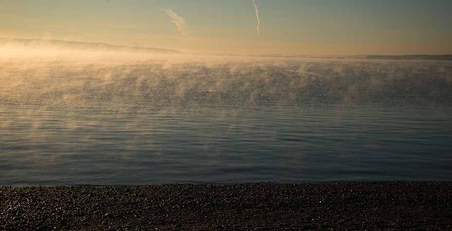 Water evaporates from the sea as appears to be boiling.