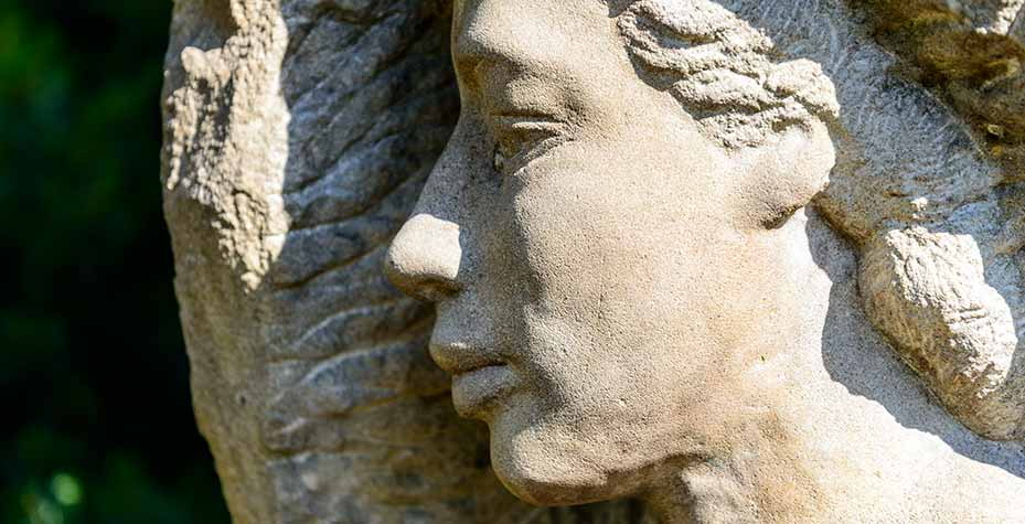 A stone face appears to be sleeping, the head turned to one side