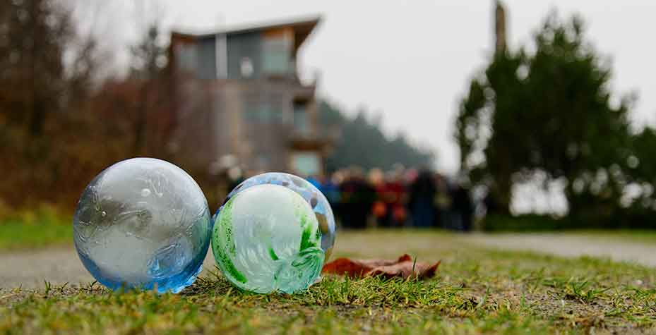 Three glass balls on the ground, an easy find for those searching for glass balls.
