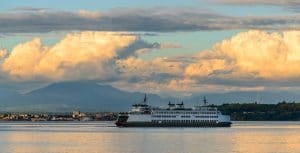 The ferry steaming toward Whidbey Island with puffy white clouds overhead