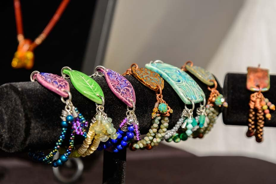 Brightly colored bracelets sit on display.