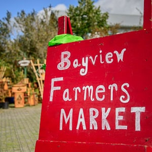 "Hand made sign says ""Bayview Farmers Market"""