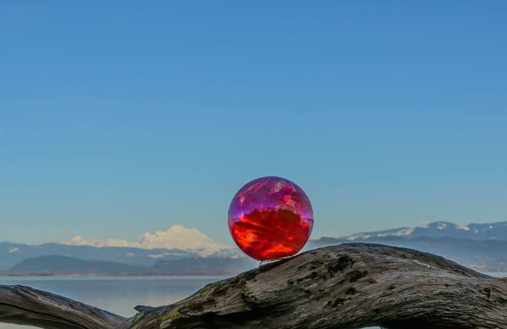 Glass Ball with snow covered mountains in the background