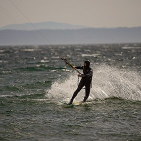 A kite surfer out on the water offshore from Whidbey Island