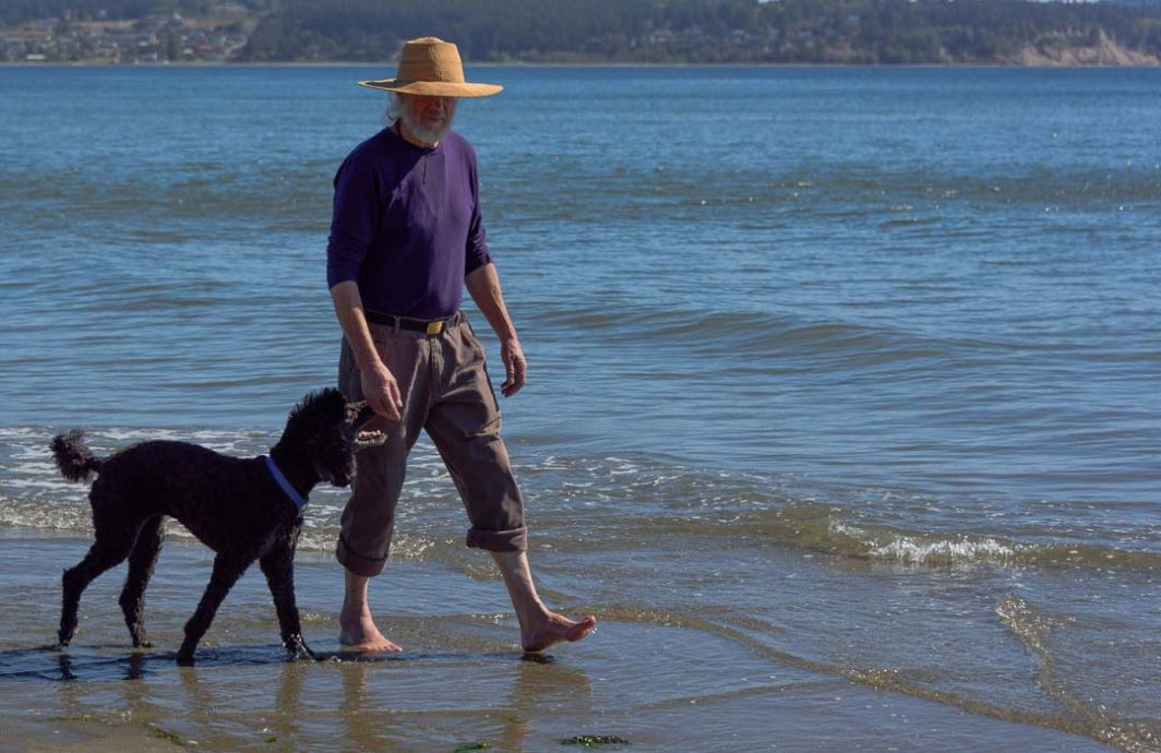 Dog and Owner walking on Double Bluff Beach
