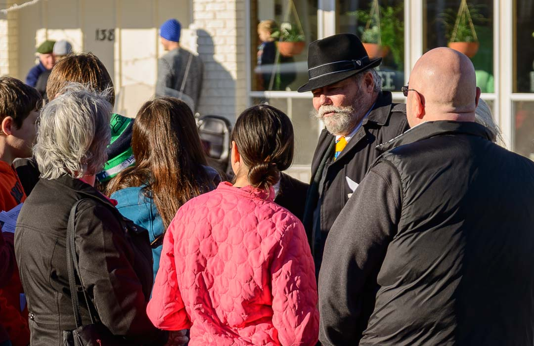 People gather around a witness during Langley Mystery Weekend.