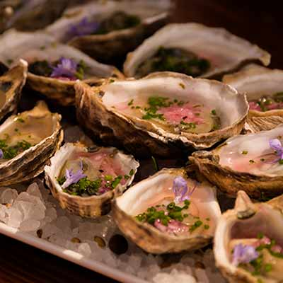 Pretty plate of oysters with spicy ingredients
