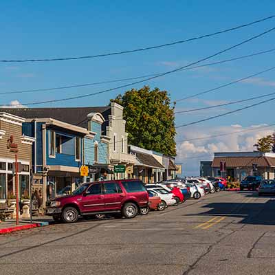 Cars parked in front of the shops on Langley's First Street.