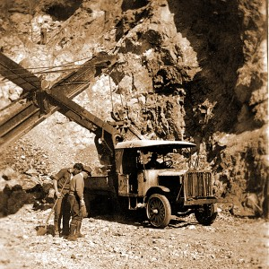 Workers and machinery during excavation for the construction of the Deception Pass Bridge.