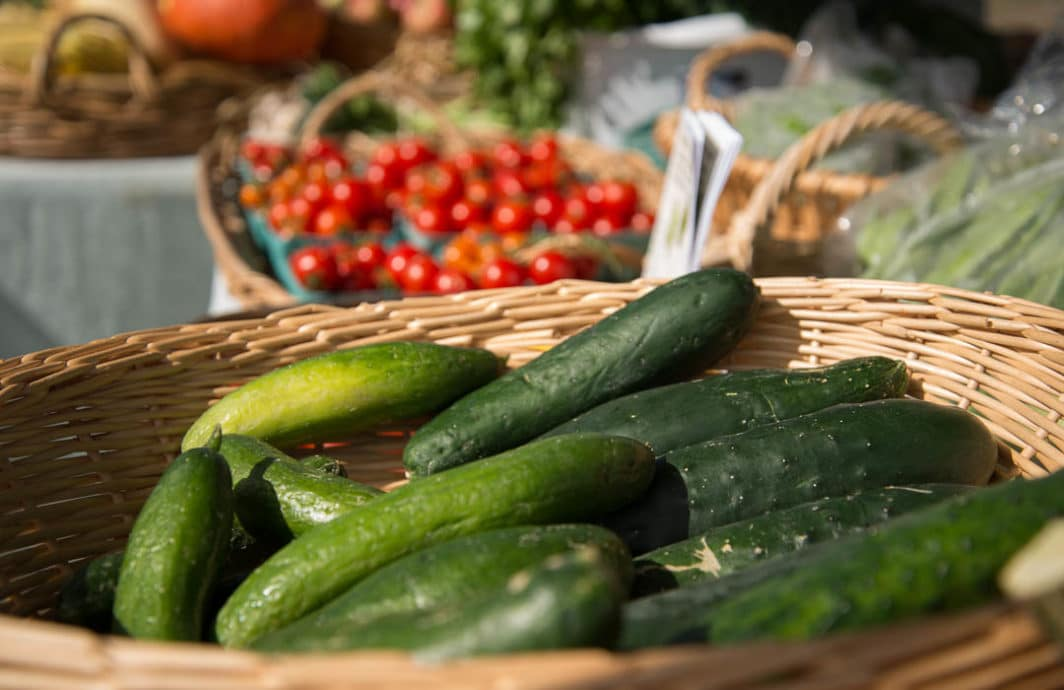 zucchini and tomatoes at a farmers market