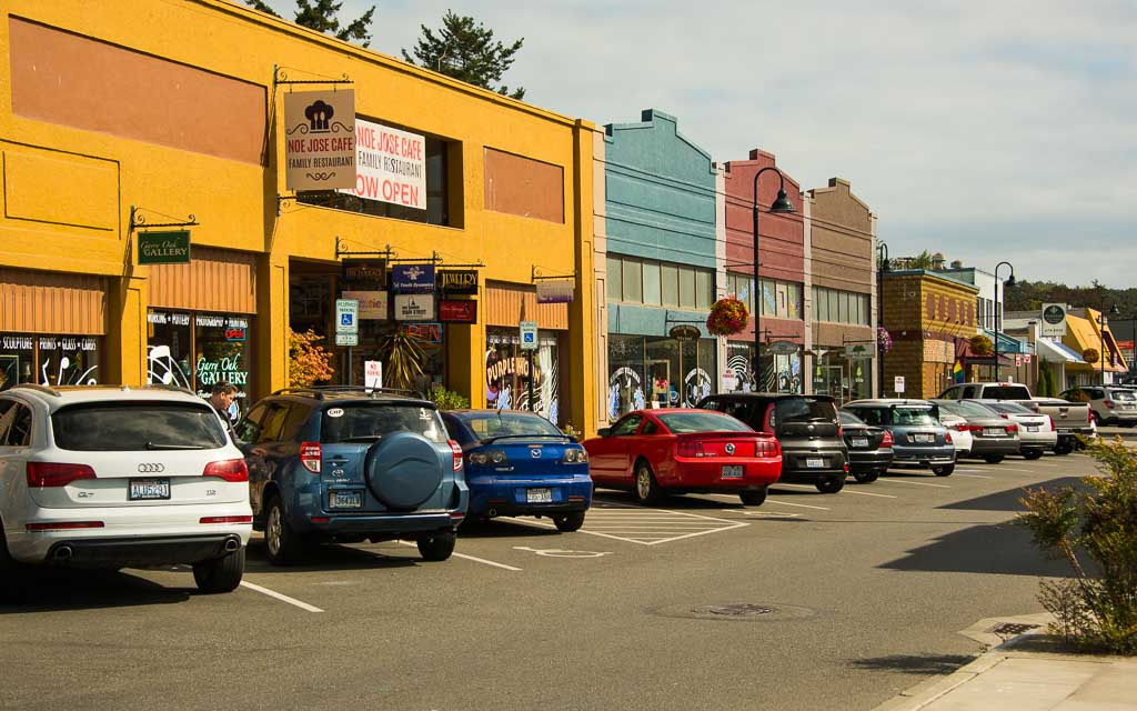 Cars parked in front of stores in downtown Oak Harbor.
