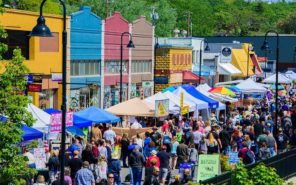 "Merchant tents in the street on Pioneer Way during the festival, ""Holland Happening."""