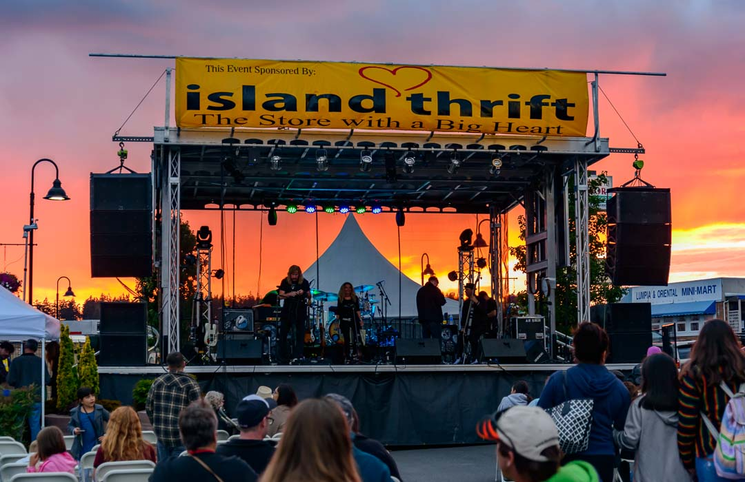 Sunset behind a stage at the Oak Harbor Music Festival