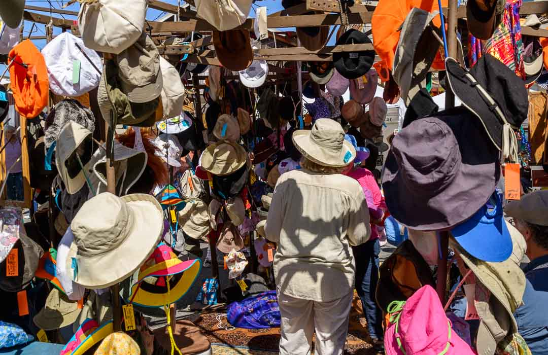 Woman surrounded by hats