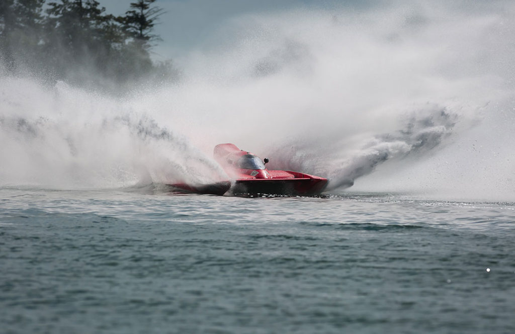 Jet boat with water splashing all around it