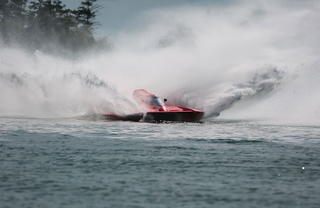 Jet boat with water splashing all around it
