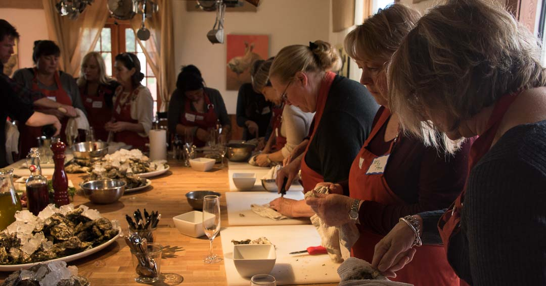 Students at their workstations in cooking school at The Orchard Kitchen