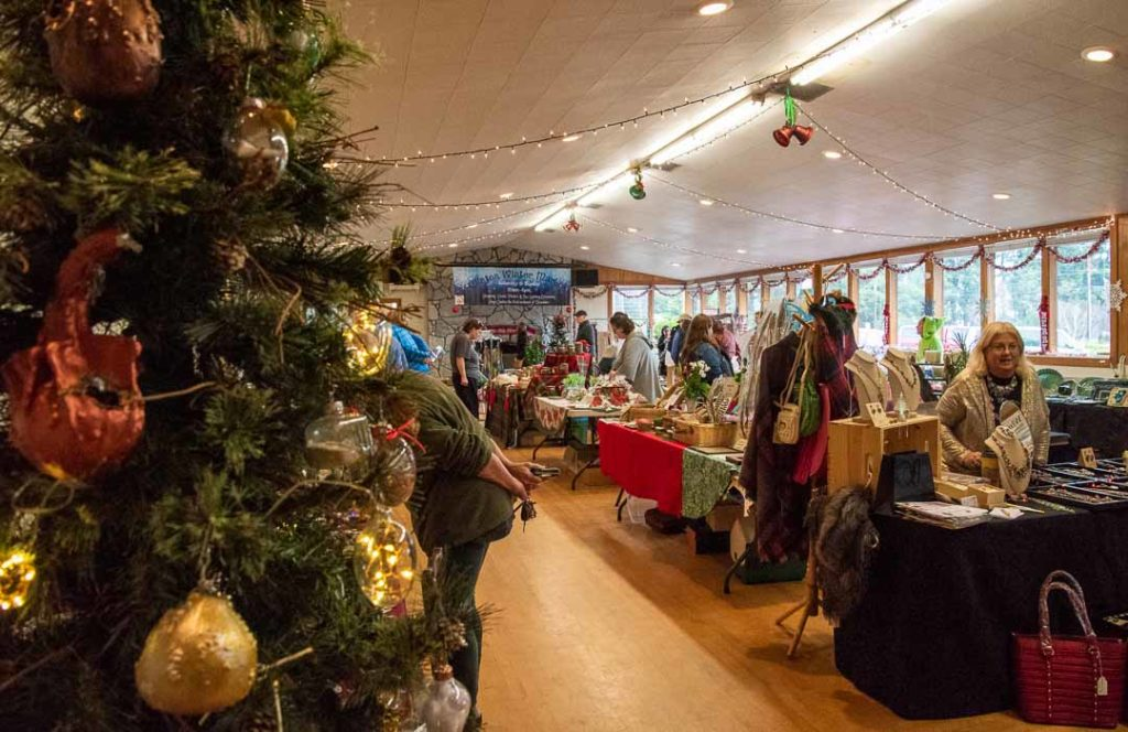 Shoppers look through hand-made crafts at Clinton's Winter Market