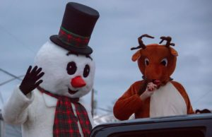 Frosty the Snowman and Rudolph the red-nesed reindeer ride the the Coupeville Christmas Parade