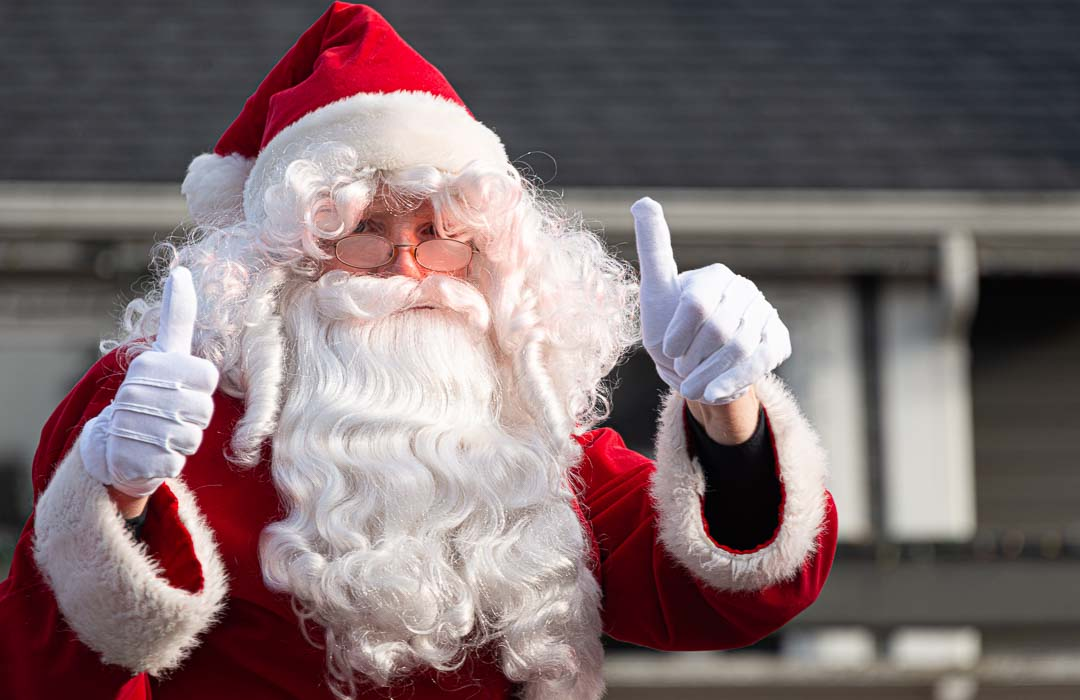 """Santa gives the """"two thumbs up"""" sign in the Langley Parade"""