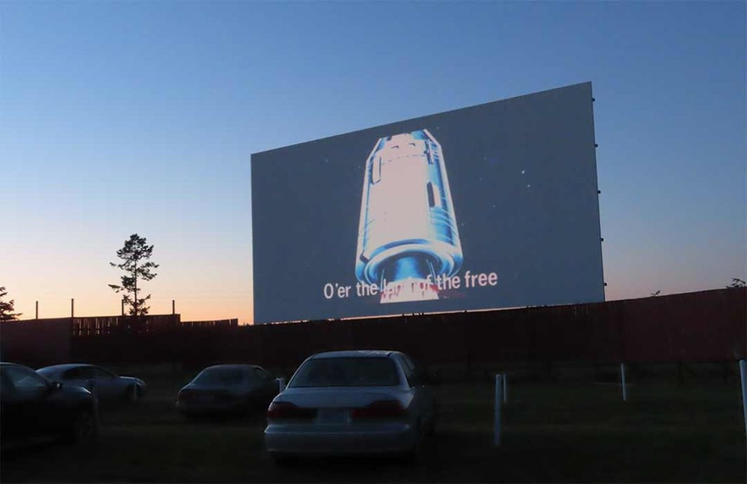 Blue Fox Drive-In Screen playing the National Anthem